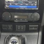 Denso raus und Doppel Din plus eigenbau Radioblende rein. Taadaaa ;-)